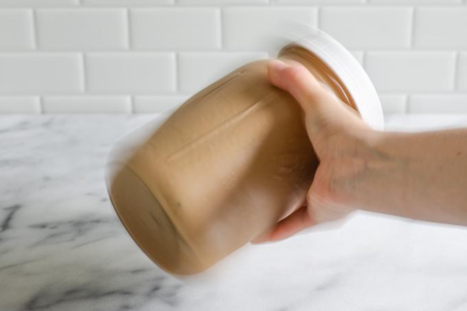 Shaking the jar to make a mocha shakerato.