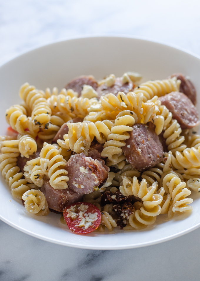A pasta bowl filled with sausage, feta, and sundried tomato pasta. Just one of 5 family dinner ideas!