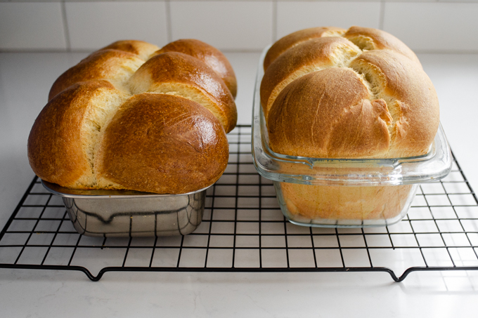 The baked loaves of sourdough brioche cooling on a wire rack.