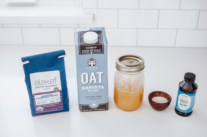 All of the ingredients needed to make an oat milk latte.