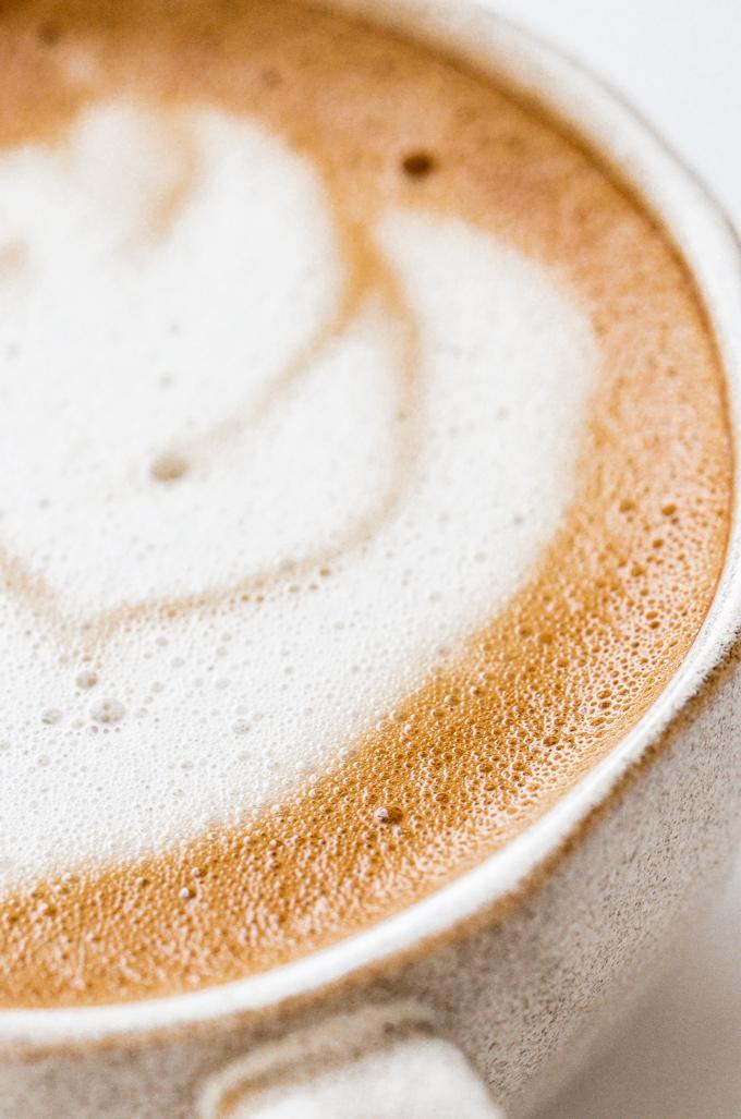 Close up shot of an oat milk latte