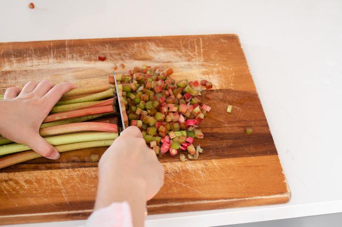 Chopping rhubarb stalks.